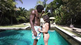 Gorgeous outdoor sex scenes by the pool between a pygmy girl and a black stud