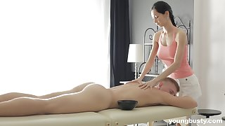Slender masseuse with obese tits Emma L gets intimate with one of her clients